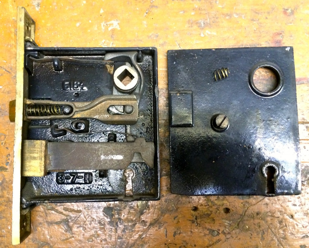 "Mortise lock from ""Frank's Office"" door. I've already temporarily inserted the broken spring from the bathroom door. And note what's probably the patent year in the lower left: 3-7-11. That's before the Titanic sank."